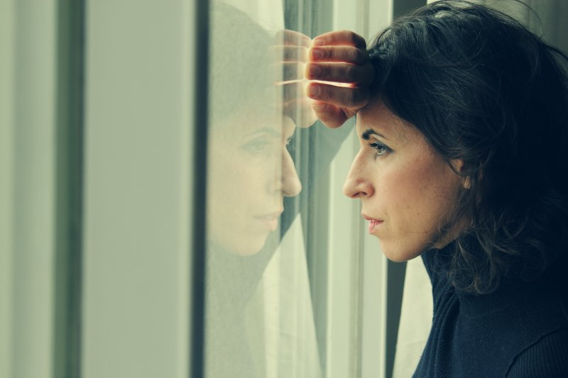 A woman staring out of a window.